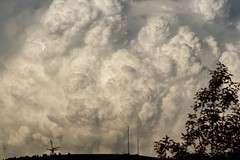 Thunderstorm cloud 8 (bichane) Tags: storm scale silhouette hill ground aerial land huge thunderstorm mast puffy boiling violent thunderhead cumulous