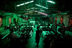 Man and Machine (Sopnochora) Tags: roof light boy man thread factory machine spinning inside bangladesh garments insideroom mdhuzzatulmursalin threadfactory sopnochora
