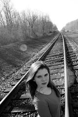 Don't Test Me (NAMaroon) Tags: railroad light blackandwhite bw sun girl train death emotion traintracks angry emotional solarflare