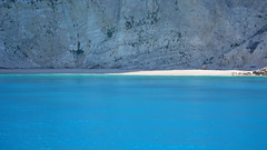 Il confine tra l'ombra e la luce - The border between shadow and light (Ola55) Tags: sea beach rock sand mare greece grecia roccia spiaggia italians sabbia lefkada the4elements mywinners aplusphoto worldtrekker yourcountry ola55 sailsevenseas