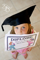 Small genius :) (Kidzmom2009) Tags: proud happy funny diploma little sweet blueeyes innocent graduation intelligence cap littlegirl preschool reward peeking diplome 5yearsold highangleview preschooldiploma kidzmom2009 gettyimageswants kfsphotography preschoolgirlholdingdiploma holdingpreschooldiplomainmouth