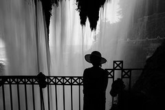 Under the waterfall (Elios.k) Tags: light blackandwhite motion water girl hat silhouette horizontal outdoors waterfall falling greece edessa oneperson ελλάδα karanos monom έδεσσα κάρανοσ