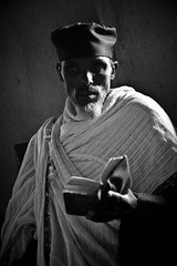 Priest reading Holy writings in a monastery. Tana lake, Ethiopia (NeSlaB .) Tags: world poverty africa portrait blackandwhite lake church canon religious temple photo blackwhite christ faith prayer religion jesus philosophy clothes celebration monastery priest meditation christianity ethiopia orthodox rite bahirdar pilgrim rites developingcountries reportage pilgrims etiopia amhara tigray tanalake neslab