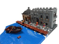 Attacking the Harbor (Grant W.) Tags: windows house building castle water facade harbor boat dock lego barrel attack tudor cobblestone pirate detailed pillage pirateattack attackingtheharbor