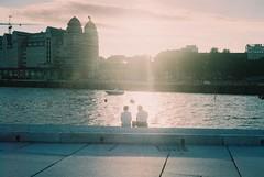 Oslo (Richard Stewart James Gaston) Tags: sunset sea sun house color colour film water silhouette oslo night 35mm river boat opera couple richard gaston