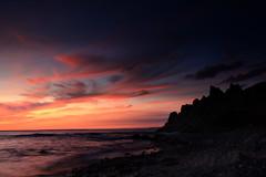 Seascapes take 2 (Deryk Tolman) Tags: longexposure sunset red sea cliff cloud seascape beach nature water rock clouds landscape coast twilight waves britain wideangle august pebbles shore jersey british 18mm canonefs1855 2011 canon450d blackcardtechnique