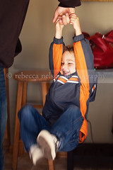 Hanging On (Rebecca812) Tags: family boy love smile fun happy togetherness kid movement holding child play hand action father joy son swing holdinghands everyday care simple bonding canon5dmarkii rebecca812 heritage2011