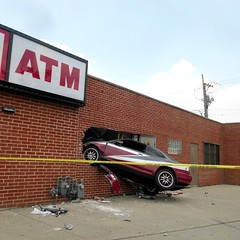 car stuck in a building, North & Kedzie, Chicago (katherine of chicago) Tags: chicago cars accidents carnage humboldtpark crashes chicagoist