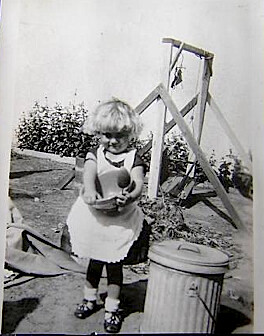 Vintage Little Girl in apron
