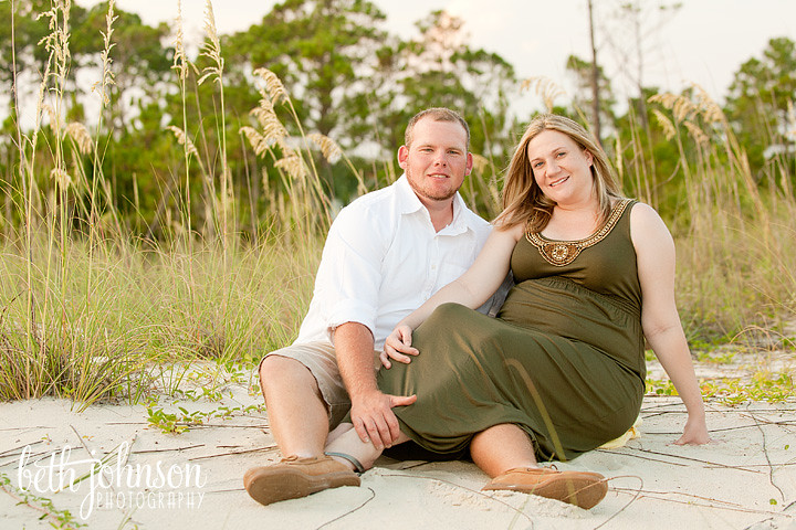 maternity photography session by sea oats on beach