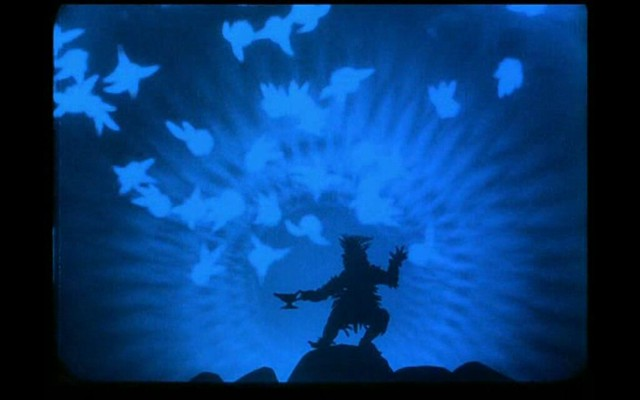 A black silhouette of Witch releasing good spirits, visualized with lighter shadows from the lamp against a blue background.