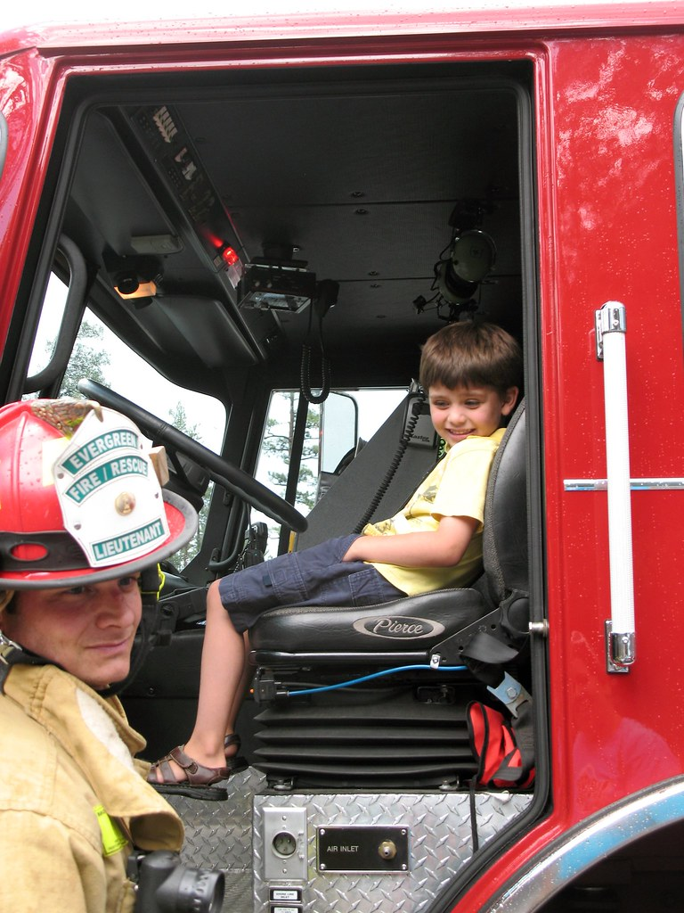 Austin sitting in the fire engine