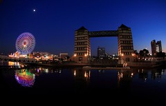 Yokohama at Night ( Spice (^_^)) Tags: blue sky art water japan night canon buildings reflections dark landscape photography eos bay photo asia flickr december colours image picture blogger livejournal  yokohama  minatomirai  2009    facebook       kanagawaken twitter ferrizwheel tumblr