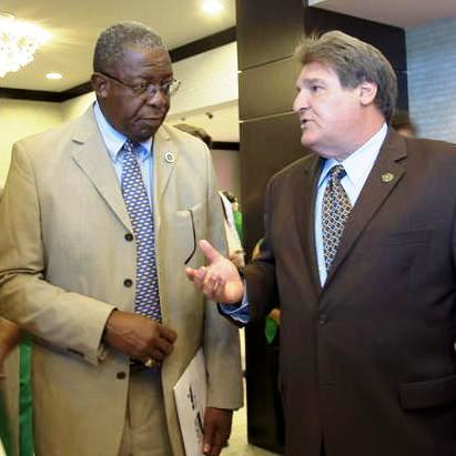 USDA Rural Development State Director, Clarence W. Hawkins and Thomas G. Christopoulos (hotel owner) in the newly opened hotel.