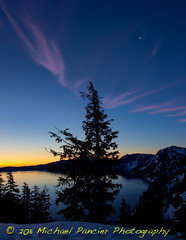 Crater Lake Sunrise with Crescent Moon (Michael Pancier Photography) Tags: sun moon snow oregon sunrise volcano pines pacificnorthwest craterlake nationalparks chill crescentmoon craterlakenationalpark commercialphotography naturephotographer oregonbirds pacificnorthwestbirds michaelpancierphotography landscapephotographer fineartphotographer michaelapancier americasnationalparks wwwmichaelpancierphotographycom