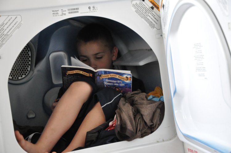 Luke reading in dryer