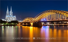 Cathedral & Hohenzollern Bridge - Cologne - Germany (~ Floydian ~ ) Tags: longexposure travel bridge reflection church water canon reflections river germany stars boats deutschland star reflecting boat twilight europe long exposure cathedral cologne romance romantic bluehour brug rhine koln meijer rijn henk klnerdom keulen hohenzollern northrhinewestphalia smoothwater floydian proframe proframephotography canoneos1dsmarkiii henkmeijer