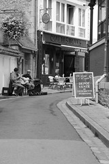 Side-street Corner Café (D.O'Bhrionn) Tags: street blue red bw music food brown white france colour green cup coffee café metal musicians silver town milk yummy aqua market tea chocolate olive tasty funky clothes dresses rails picturesque hangers languex