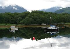 loch leven - Scotland (torinouk) Tags: mountain reflection clouds mirror scotland boat pond loch leven