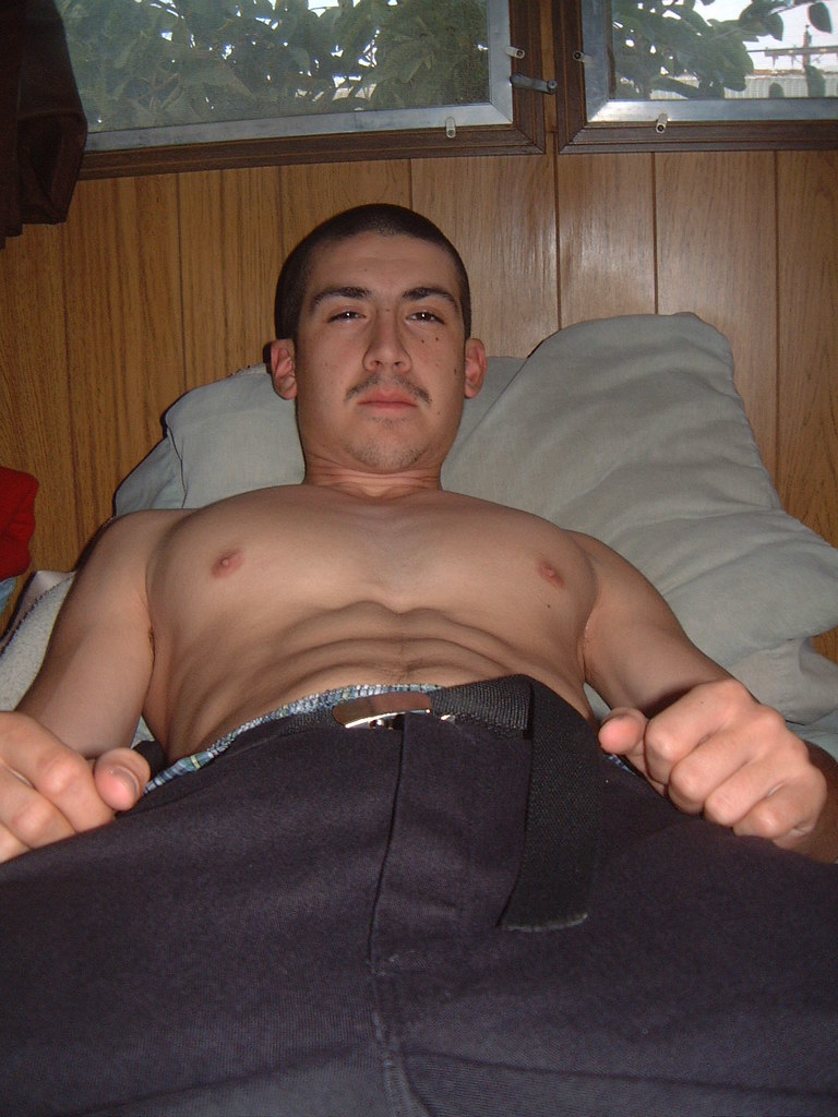 shirtless guy in bed