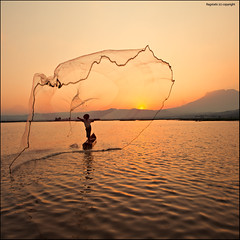 Local Fisherman at work (Ragstatic) Tags: sunset sky orange sun lake net water indonesia volcano java boat nikon rags nationalgeographic d700 rawapening