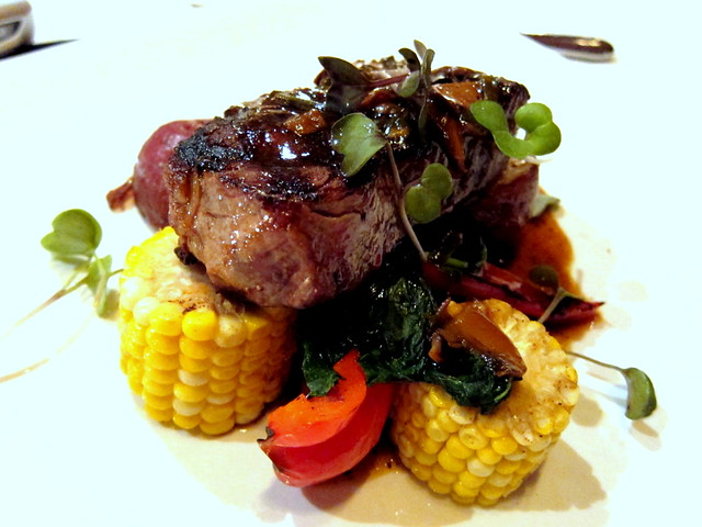 Grilled 10 oz Beef Striploin, Mushroom Veal Jus, served with Roasted Herbed Polenta and Peppers