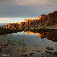 Sunset by your side (Dora Joey) Tags: light sunset sun mountain lake canon landscape mirror tramonto sole rosso montagna luce paesaggio dolomites belluno dolomiti specchio riflesso passogiau idream 60d canon60d bestcapturesaoi