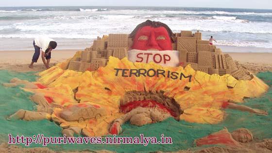 "A sand sculpture on ""Stop Terrorism"" at sea beach, Puri"