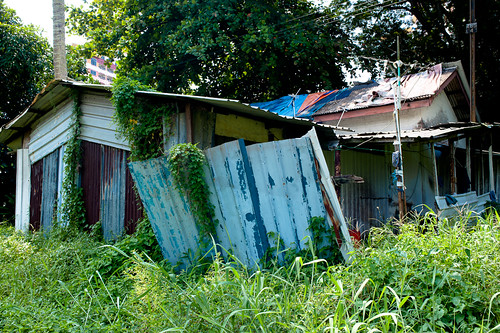 Abandoned Kampong style house along the tracks