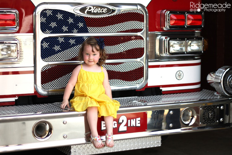 Mabry on the front of the fire truck