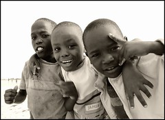 three friends (1) (Amsterdamned!) Tags: africa friends portrait beach boys topf25 sepia kids children coast eyes faces emotion kenya expression retrato joy ritratto f25 mombasa f40 bamburi