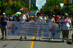 Five people carrying the Shiloh-Sixth Avenue United Church of Canada banner in the Vancouver Pride Parade by bott.richard