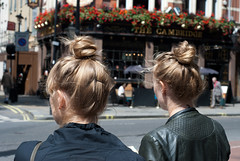 two buns (SimoneFisher) Tags: street england people london hair twins women circus buns hairstyle keep1 ditch1 ditch2 ditch3 ditch6 ditch8 ditch9 ditch10 ditch5 ditch7 dicth4
