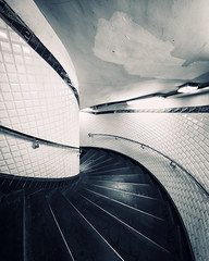 Spiraling Downwards (Philipp Klinger Photography) Tags: light shadow urban bw white black paris france art industry lamp station metal stairs tile spiral nikon frankreich europa europe industrial angle metro metallic mtro wide descent wideangle down montmartre ceiling glossy artnouveau tiles staircase gloss railing nouveau fx deco metall philipp iledefrance ultra metalic downwards descending ballustrade klinger ultrawideangle spiraling mtroparisien d700 mtrodeparis