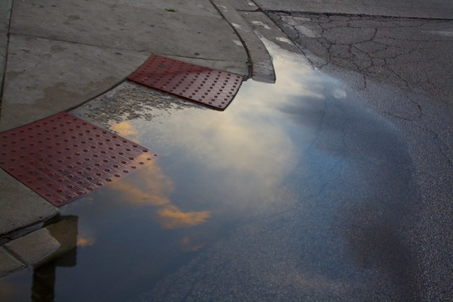 Sunset in a flooded gutter