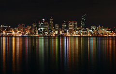 Alki Beach View of Downtown Seattle Close-up (Bryden McGrath) Tags: seattle longexposure light reflection colors skyline washington nightscape skyscrapers pacific northwest westseattle pacificnorthwest alkibeach pugetsound downtownseattle