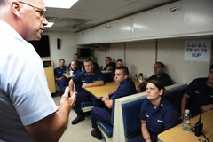 A meeting on the mess deck of CGC FRANK DREW