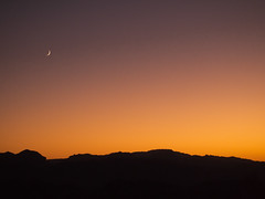 the new moon chases the setting sun (nosha) Tags: sunset arizona usa moon beautiful beauty landscape az havasu lightroom 2011 nosha olympusm1442mmf3556iir olympusepl3 lakehavasuarizonausa