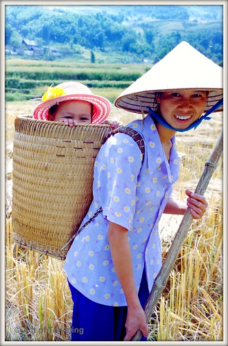 Woman and child in rice field near Sapa, Vietnam