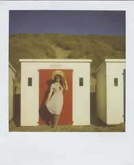 Beach Hut Beauty (Lizzie Staley) Tags: blue red summer white film beach hat sunglasses fashion vintage pose polaroid sx70 seaside sand 60s elizabeth dress dunes 1940s 600 beachhut 1960s expired 40s 2011