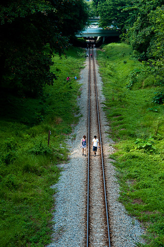 Couple along the tracks