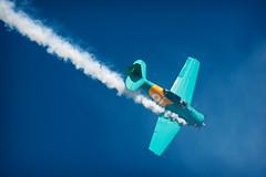 Flying like a bird (Edi Eco) Tags: show brazil sky sport brasil canon airplane rebel aircraft smoke radical aviao oi ceu brotas broa flyin esquadrilha fumaca xsi acrobatic aeronautica esport piloto acrobacia areo 55250mm thepathdaily