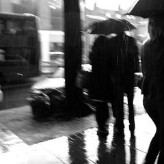 Sketch (Che-burashka) Tags: bw london wet rain silhouette umbrella reflections bn rainy umbrellas islington canonef28mmf18usm urbanlyric