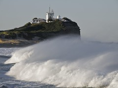 Nobby's..... (Peter Knott) Tags: ocean sea lighthouse seascape beach newcastle dangerous aperture surf shorelines shoreline wave australia olympus shore nsw e3 zuiko gitzo huntervalley nobbys zd 50200mmswd newcastlesundance gt2542l