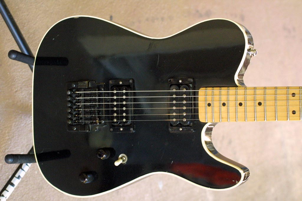 question about an s schecter i found it s also hard for me to tell if it s one of the original california guitars what do you guys think the pick ups and bridge have obviously been replaced