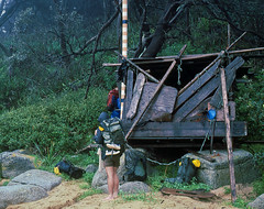 Flotsam and jetsam hut, 1985 (NettyA) Tags: ocean park sea house film beach rain 35mm easter coast sand flood hiking australia slide victoria hut national bushwalking scanned shack flotsam 1985 gippsland jetsam croajingalong bushwalkers croajingolongnationalpark janettetomsett