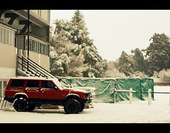 Nothing will stop us (bkiwik) Tags: trees winter red newzealand christchurch snow car architecture digital truck work canon jeep 4wd pickup canterbury nz vehicle snowing dslr snowfall winterwonderland christscollege eos400d jeepcherokeesport christscollegecanterbury