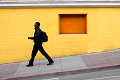 strident (bhautik joshi) Tags: sf sanfrancisco california street orange yellow wall walking walk candid hill pedestrian sidewalk sfist descending stride haightst 2011 fillmorest striding bhautikjoshi
