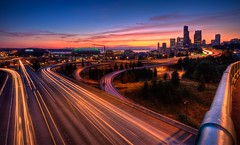 Seattle In Motion (Fresnatic) Tags: seattle mariners pacificnorthwest seahawks lighttrails safecofield washingtonstate hdr freeways lightroom interstate5 olympicmountains seattlesunset interstate90 sounders photomatix 12thstreetbridge drjoserizalbridge canonrebelxsi seattlehd