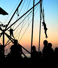 'silhouetted by the sea' (David Willis.) Tags: sunset sea sun playing beach silhouette children jumping spain sand streetphotography bobdylan ropes malaga fuengirola trampolines davidwillis canong10
